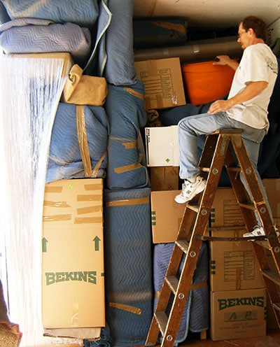 A & P Moving staff member packing truck for long distance move